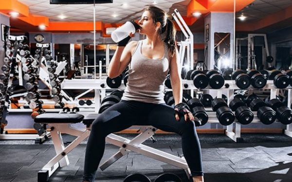 women drinking protein shake