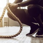 man with battle ropes